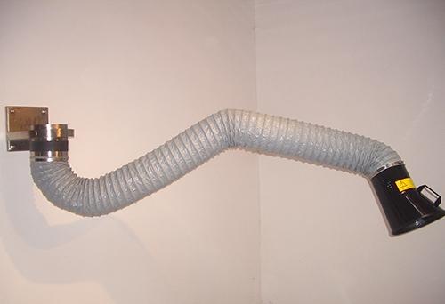Flexible suction arm